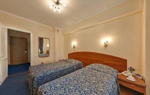 Кровать или кровати в номере Отель Аэрополис