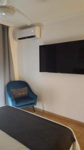 A television and/or entertainment center at VILLA MOLEIRO- LA TEJITA