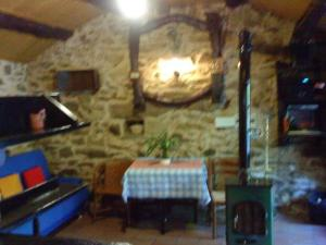 A restaurant or other place to eat at Molino de Louzao