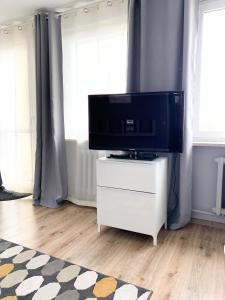 Telewizja i/lub zestaw kina domowego w obiekcie Apartament Kotwica