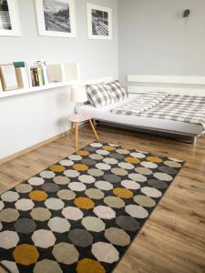 Łóżko lub łóżka w pokoju w obiekcie Apartament Kotwica