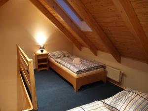 Кровать или кровати в номере Penzion Vital