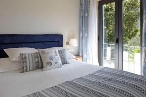 A bed or beds in a room at Quinta de la Rosa