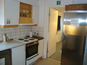 A kitchen or kitchenette at Polar Lodge