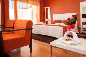 A bed or beds in a room at Hotel Miramar Sul
