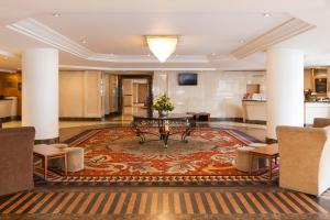The lobby or reception area at ibis London Earls Court