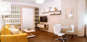 A seating area at Apartment Elegance Hrebienok