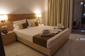 A bed or beds in a room at Marvel Deluxe Rooms