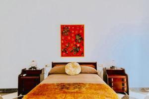 A bed or beds in a room at Villa El Cerrillo