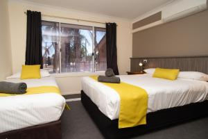 A bed or beds in a room at Manera Heights Apartments