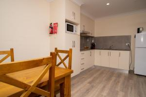 A kitchen or kitchenette at Manera Heights Apartments