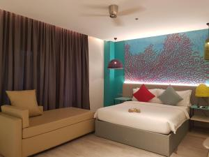 A bed or beds in a room at Lagùn Hotel