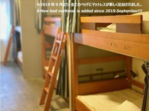 A bunk bed or bunk beds in a room at Imano Tokyo Hostel