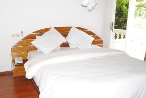 A bed or beds in a room at Kiriri Residence Hotel