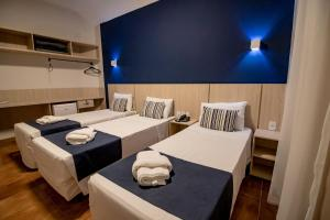 A bed or beds in a room at Rio das Pedras Thermas Hotel