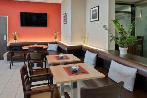 Ein Restaurant oder anderes Speiselokal in der Unterkunft Austria Trend Hotel Salzburg Mitte