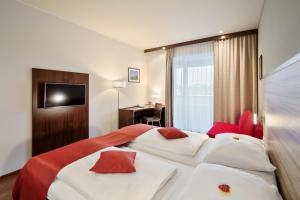 Ein Bett oder Betten in einem Zimmer der Unterkunft Austria Trend Hotel Salzburg Mitte