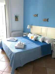 A bed or beds in a room at Il Miraggio