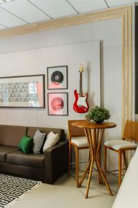 A seating area at Tri Hotel Smart Criciuma