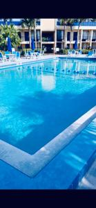 The swimming pool at or near Days Inn by Wyndham Orlando Airport Florida Mall