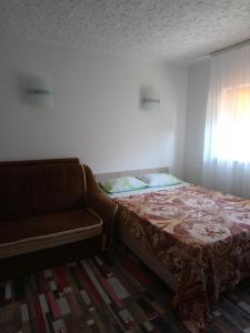 Кровать или кровати в номере Частный сектор Aquarelle