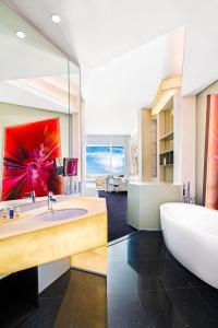 A bathroom at V Hotel Dubai, Curio Collection by Hilton