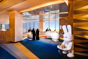 The fitness center and/or fitness facilities at V Hotel Dubai, Curio Collection by Hilton