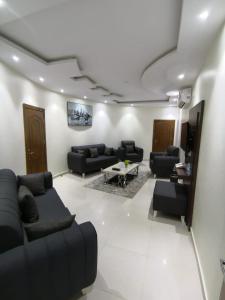 Uma área de estar em Milaf Hotel Apartments