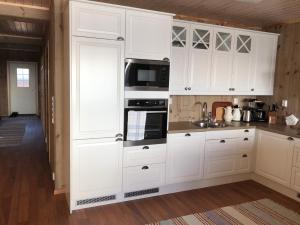 Kjøkken eller kjøkkenkrok på Laukvik Suites