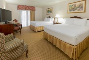 A bed or beds in a room at Music Road Resort