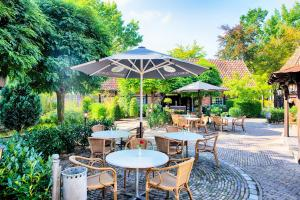 A porch or other outdoor area at Welcome Hotel Dorf Münsterland