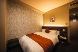 Кровать или кровати в номере Hotel Patio Dogo