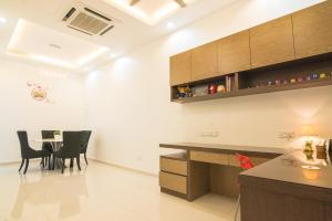 A kitchen or kitchenette at Landed Cozy House Near SPICE, Airport