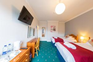 A television and/or entertainment centre at The Clee Hotel - Cleethorpes, Grimsby, Lincolnshire