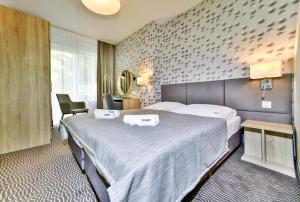 Łóżko lub łóżka w pokoju w obiekcie Akces Medical Fit & Spa