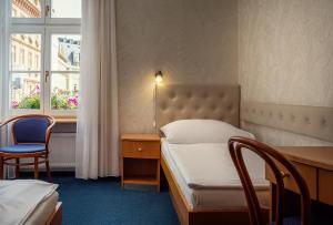 Postel nebo postele na pokoji v ubytování Hotel Ruze