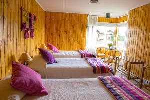 Cama o camas de una habitación en Hotel del Paine
