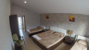A bed or beds in a room at Göygöl Olimpiya