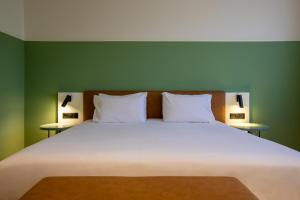 A bed or beds in a room at Eurostars Acteón
