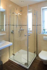Ванная комната в Brauerei Gasthaus Lohhof