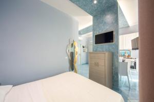 A bed or beds in a room at La Casa del Poeta - Appartamento Ravello