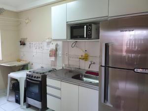 A kitchen or kitchenette at Sossego em Ilhéus