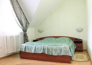 Кровать или кровати в номере Гостиничный комплекс Колыба