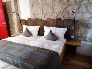 Ein Bett oder Betten in einem Zimmer der Unterkunft come prima