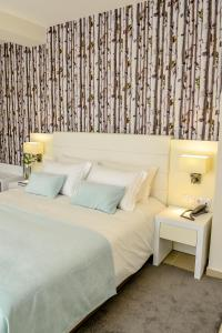 A bed or beds in a room at Villamar Style Maison