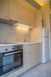A kitchen or kitchenette at Fata Morgana Studios & Apartments