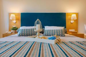 A bed or beds in a room at Dolphin Bay Family Beach Resort