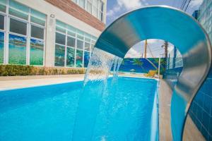 A piscina localizada em Pousada Marie Claire Flats ou nos arredores