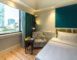 A bed or beds in a room at Saigon Prince Hotel