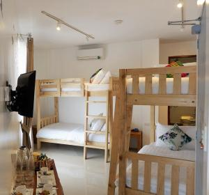 A bunk bed or bunk beds in a room at Kamusta Boutique Hotel